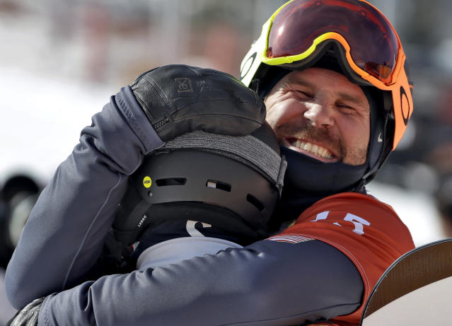 American snowboard cross rider Nick Baumgartner, right, hugs teammate Mick Dierdorff after their semifinal race at the 2018 Winter Olympics on Thursday. (AP)