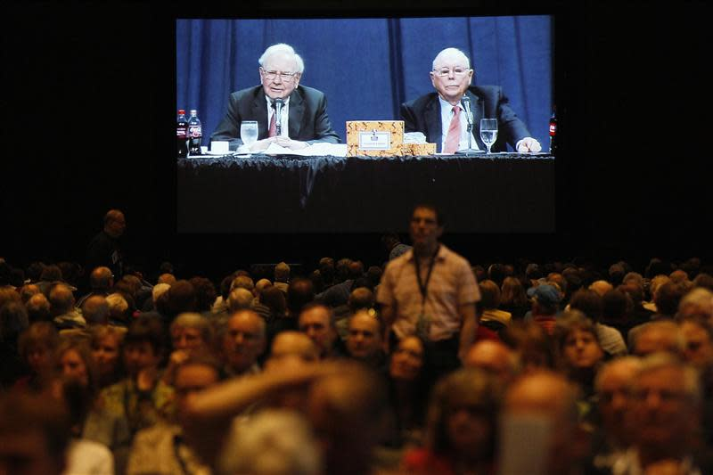 Berkshire Hathaway shareholders listen to CEO Warren Buffett and vice-chairman Charlie Munger seen on a projection screen in the background at the annual meeting in Omaha