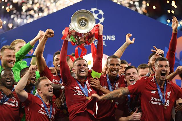 Jordan Henderson of Liverpool lifts the Champions League Trophy(Photo by Matthias Hangst/Getty Images)
