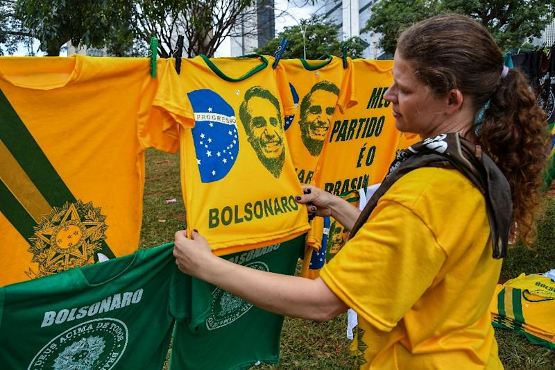 T-shirts with the image of Brazilian president-elect Jair Bolsonaro for sale in Brasilia, on the eve of his inauguration ceremony (AFP Photo/NELSON ALMEIDA)