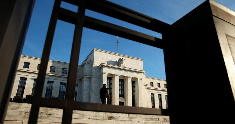 A police officer keeps watch in front of the U.S. Federal Reserve in Washingto