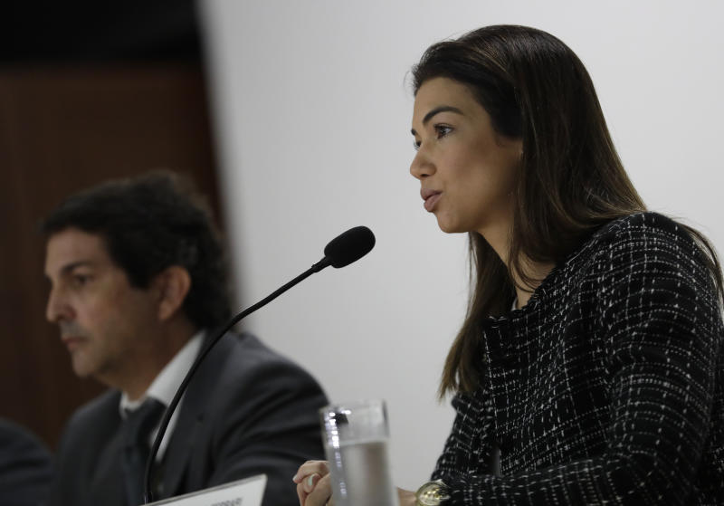 Prosecutor Marisa Ferrari speaks during a press conference about the investigation into kickbacks and money laundering that they say involve Paraguay's former President Horacio Cartes, at the Federal Police headquarters, in Rio de Janeiro, Brazil, Tuesday, Nov. 19, 2019. On Tuesday, Brazilian authorities alleged Cartes provided $500,000 to a criminal organization at the request of Dario Messer, a Brazilian associate who was then a fugitive facing corruption charges, prosecutors told reporters. (AP Photo/Silvia Izquierdo)