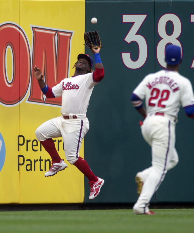 Philadelphia Phillies' Obudel Herrera catches a fly ball by Washington Nationals' Adam Eaton during the first inning of a baseball game, Sunday, May 5, 2019, in Philadelphia. (AP Photo/Laurence Kesterson)