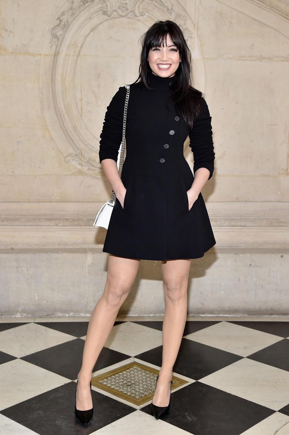 <p>Daisy Lowe was all smiles in a black coat dress. <i>[Photo: Getty]</i> </p>