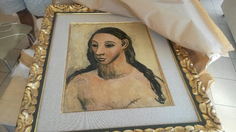 Photo taken on July 31, 2015 and released on August 3, 2015 by the French Customs Office shows the seized painting 'Head of a Young Woman' by famous Spanish painter Picasso at the Customs offices in Calvi