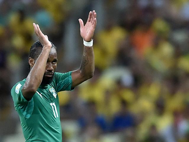 Ivory Coast's forward and captain Didier Drogba celebrates after his team scored during a Group C football match between Greece and Ivory Coast at the Castelao Stadium in Fortaleza during the 2014 FIFA World Cup on June 24, 2014 (AFP Photo/Aris Messinis)