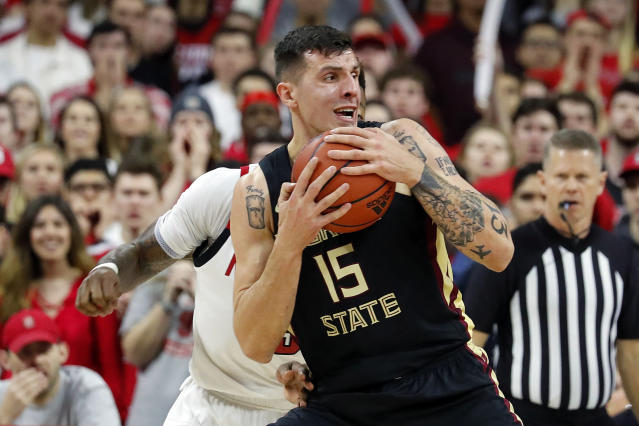 Florida State's Dominik Olejniczak (15) grabs a rebound during the first half of an NCAA college basketball game against North Carolina State in Raleigh, N.C., Saturday, Feb. 22, 2020. (AP Photo/Karl B DeBlaker)