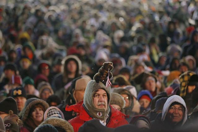 Revelers crowd the hill at Gobblers Knob waiting for the weather predicting groundhog, Punxsutawney Phil, to make his seasonal prediction Saturday, Feb. 2, 2013, in Punxsutawney, Pa. The Groundhog Club said Phil did not see his shadow and there will be an early spring. (AP Photo/Keith Srakocic)