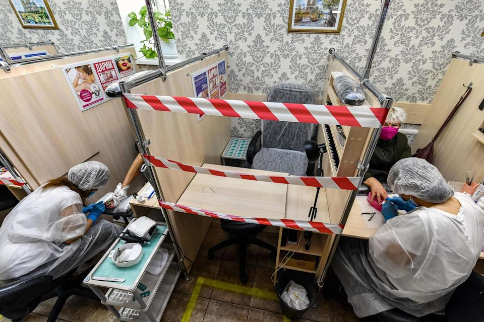 In Moscow, salons have reopened under strict guidelines (AFP via Getty Images)