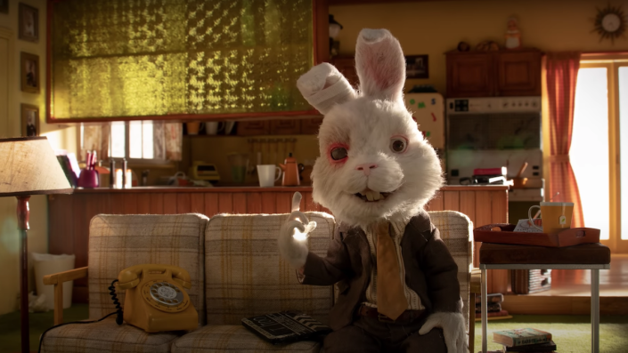 Ralph, a stop motion rabbit, sits in his living room.