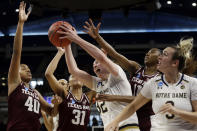 Notre Dame's Jessica Shepard (32) grabs a rebound during the first half of a regional semifinal game against the Texas A&M in the NCAA women's college basketball tournament, Saturday, March 30, 2019, in Chicago. (AP Photo/Kiichiro Sato)