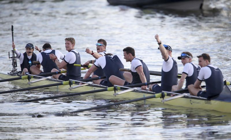 Oxford Men's crew celebrate their victory over Cambridge after the Men's Boat Race on the River Thames, in London, Sunday April 2, 2017. (Steven Paston/PA Wire via AP)