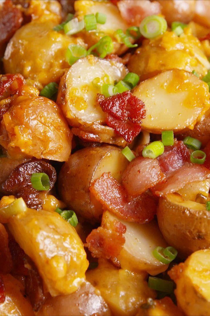 """<p>Since you're already indulging big-time on Thanksgiving, you might as well go all the way. These slow-cooker potatoes are easy to make and they're loaded up with all your favorite baked potato toppings. </p><p><strong><em>Get the recipe at <a href=""""https://www.delish.com/cooking/recipe-ideas/recipes/a50007/slow-cooker-loaded-potatoes/"""" rel=""""nofollow noopener"""" target=""""_blank"""" data-ylk=""""slk:Delish"""" class=""""link rapid-noclick-resp"""">Delish</a>. </em></strong></p>"""