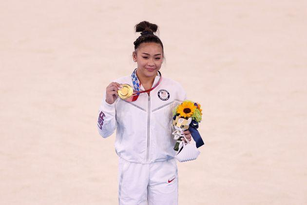 Sunisa Lee of the U.S. poses with her gold medal after winning the women's all-around gymnastics final at the Tokyo Games on July 29. (Photo: Laurence Griffiths via Getty Images)