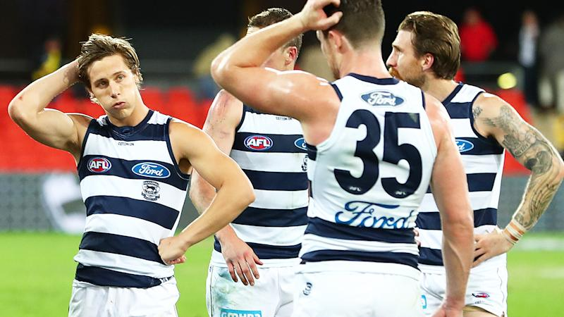 Geelong players, pictured here looking dejected after their loss to Richmond.