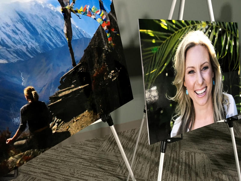 FILE - In this July 23, 2018, file photo, posters of Justine Ruszczyk Damond are displayed at a news conference by attorneys for her family in Minneapolis. Attorneys for Mohamed Noor, a Minneapolis officer who fatally shot the Australian woman last year, have been given approval to inspect the police vehicle from which the shot was fired. Noor's lawyers asked for access to the SUV Friday, Dec. 28 because the moon will be in the same phase as it was on the night in July 2017 when Damond was killed behind her home. A Hennepin County judge approved the request Thursday, Dec. 27. (AP Photo/Amy Forliti, File)