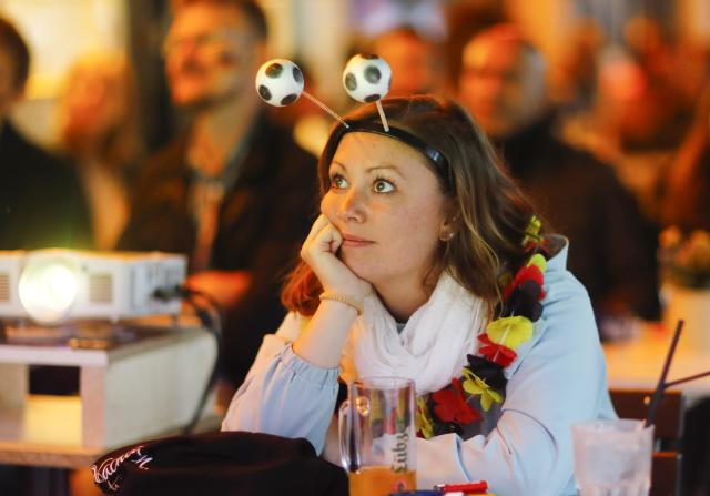 Soccer Football - World Cup - Group F - Germany vs Sweden - Berlin, Germany - June 23, 2018 A Germany soccer fan watches the match at a pub. REUTERS/Hannibal Hanschke