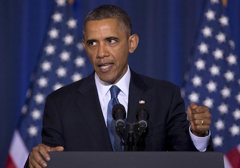 """FILE - In this May 23, 2013 file photo, President Barack Obama talks about national security, at the National Defense University at Fort McNair in Washington. Rebuffing the president's latest plea, House Republicans would keep open the military-run prison at Guantanamo Bay, Cuba, by barring the administration from spending money to transfer terror suspects to the United States or a foreign country such as Yemen. The provisions dealing with the fate of the 166 prisoners are part of a defense policy bill drafted by Armed Services Committee Chairman Rep. Howard P. """"Buck"""" McKeon, R-Calif. The chairman released the bill Monday, two days before Republicans and Democrats on the committee will vote on the measure. (AP Photo/Carolyn Kaster, File)"""