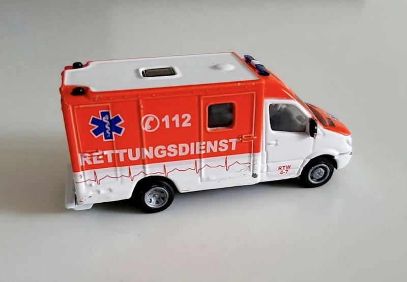 Josh spotted the emergency 112 number on the side of his toy ambulance. (SWNS)