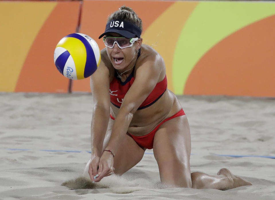 FILE - In this Wednesday, Aug. 17, 2016 ,file photo, The United States' April Ross passes a ball while playing against Brazil during the women's beach volleyball bronze medal match of the 2016 Summer Olympics in Rio de Janeiro, Brazil. April Ross will return to the Tokyo Olympics with Alix Klineman. (AP Photo/Marcio Jose Sanchez, File)