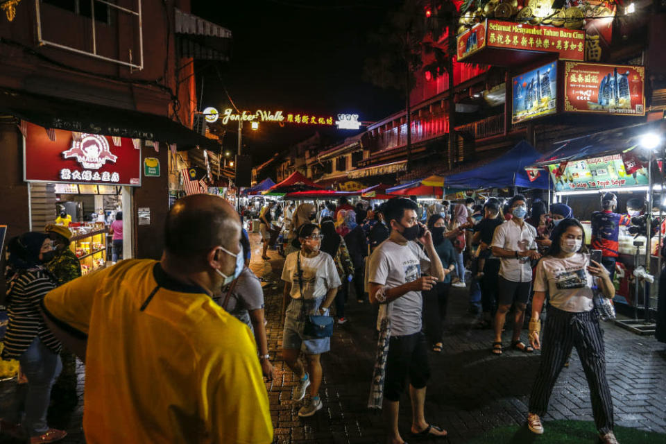 Local tourists are seen at Jonker Street in Melaka December 28, 2020. — Picture by Firdaus Latif