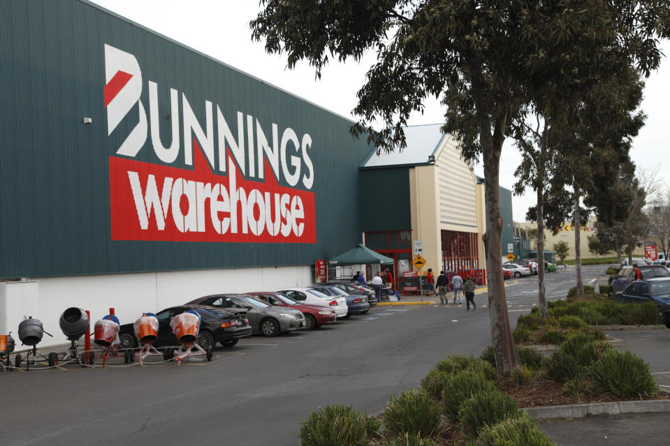 Melbourne, Australia - July 23, 2011: Bunnings is Australia\'s most successful hardware chain. Here is the outside of a store in Epping, Melbourne. It includes customers walking to the entrance, and cars parked nearby.