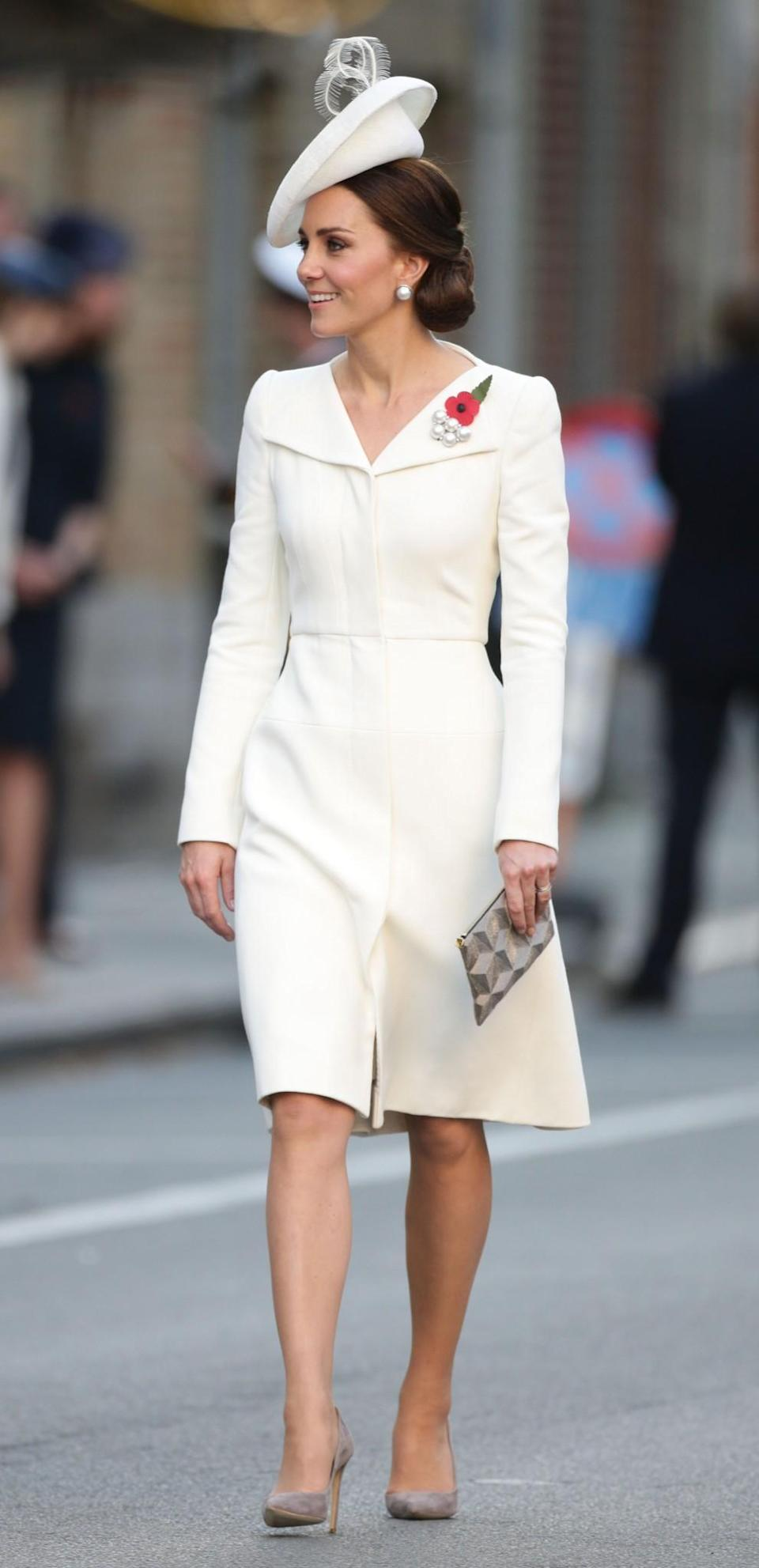 <p>The Duchess of Cambridge arrived at the ceremony commemorating 100 years since the Battle of Passchendaele in a white, Alexander McQueen ensemble: the same look she wore for Princess Charlotte's christening. <em>[Photo: PA]</em> </p>