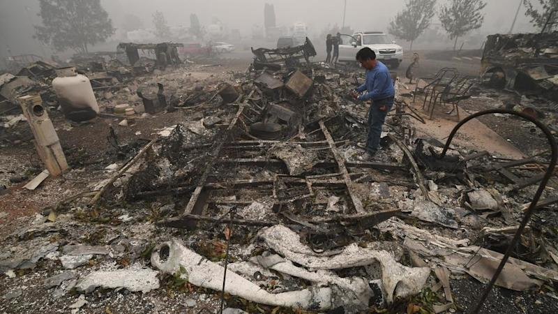 Death toll in US wildfires set to rise sharply as rescuers search through charred landscape