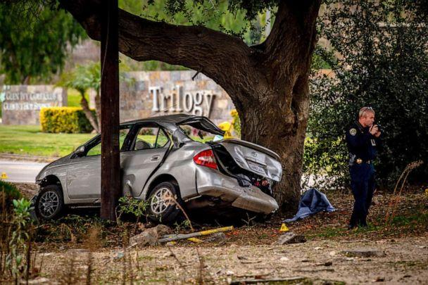 PHOTO: An officer with the California Highway Patrol's Multidisciplinary Accident Investigation Team investigates the scene of a deadly crash in the Temescal Valley, south of Corona, California, on Jan. 20, 2020. (Watchara Phomicinda/The Orange County Register via AP)