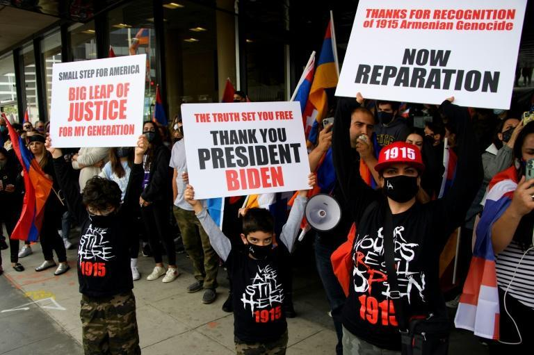 """People hold """"Thank You, President Biden"""" signs as they protest outside of the Turkish consulate in Los Angeles following Biden's declaration that Ottoman forces committed genocide against the Armenians"""
