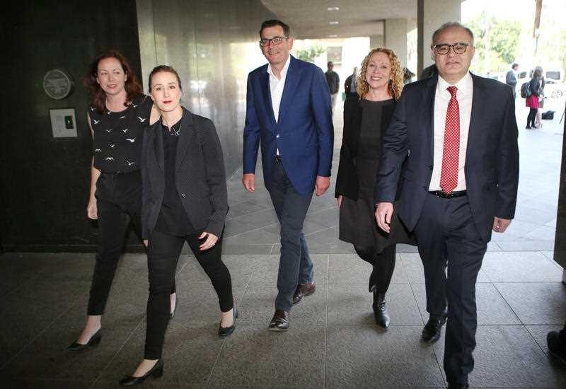 Jaclyn Symes, Gabrielle Williams, Victorian Premier Daniel Andrews, Melissa Horne and Adem Somyurek are seen during a press conference in Melbourne in 2018.