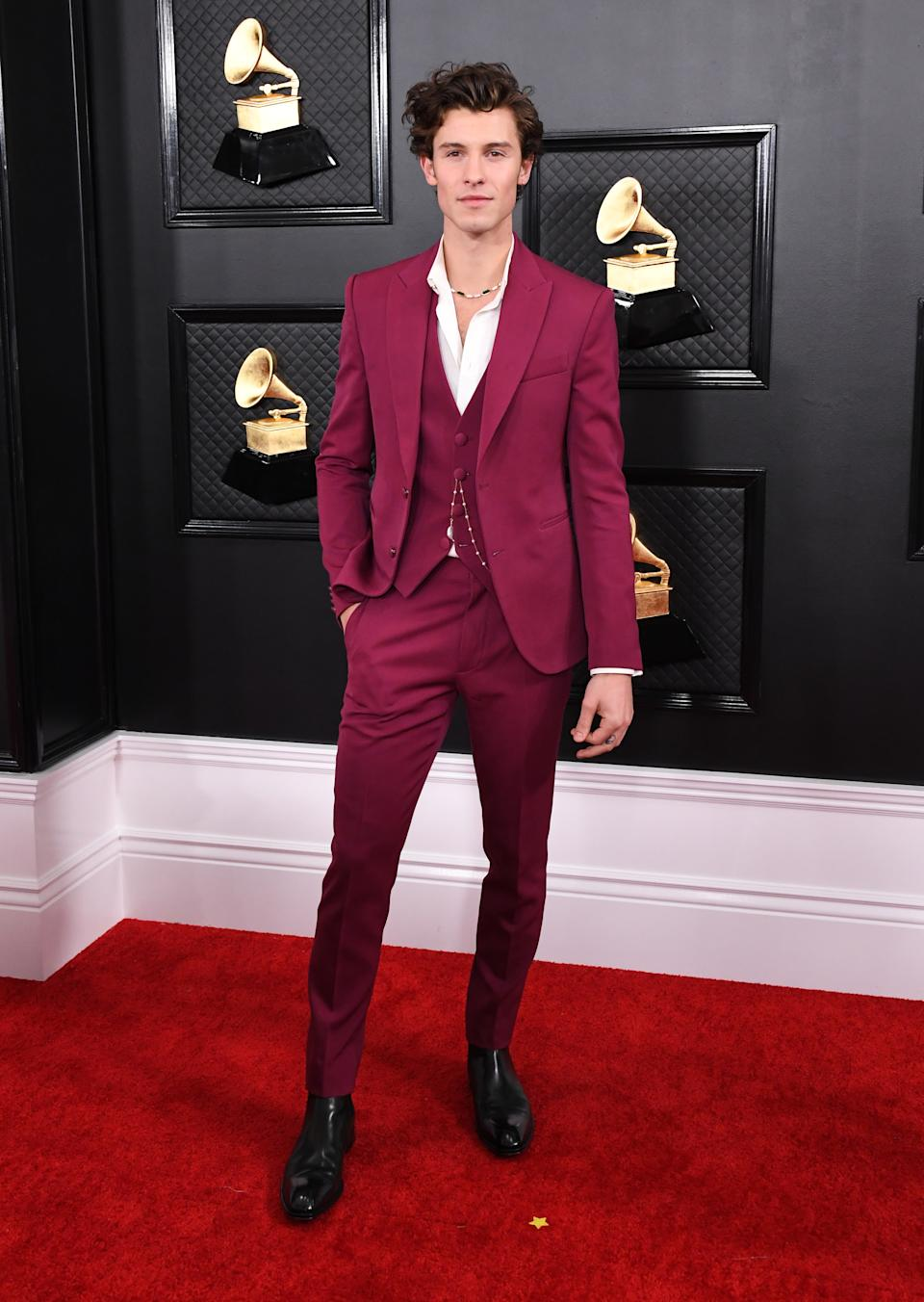 """The Canadian pop star hit the red carpet in bold magenta suit by Louis Vuitton. The 21-year-old earned a nomination for Best Pop Duo/Group Performance for his song """"Señorita"""" with girlfriend Camila Cabello."""
