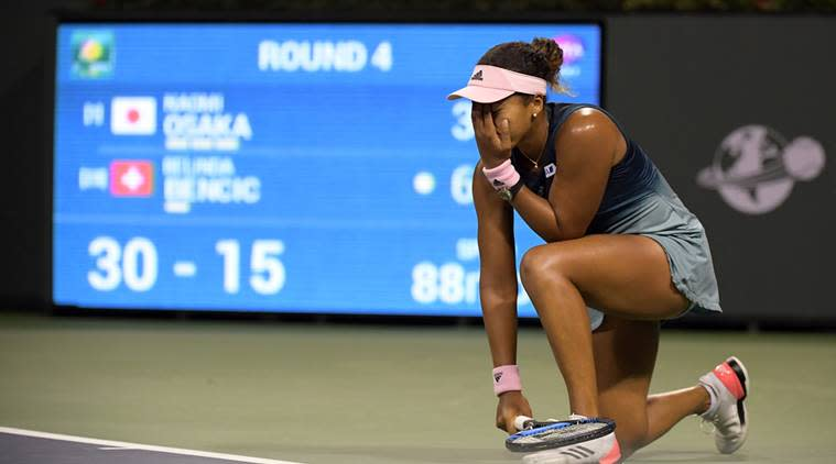 Naomi Osaka, of Japan, reacts after losing a point to Belinda Bencic at the BNP Paribas Open tennis tournament