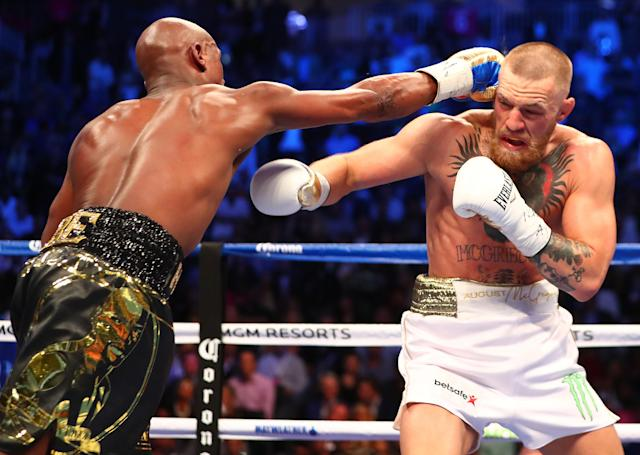 Ex-UFC champion Conor McGregor (R), boxing Floyd Mayweather in 2017, has been called out by WBA super lightweight champion Regis Progra. (Photo by Mark J. Rebilas/USA TODAY Sports)
