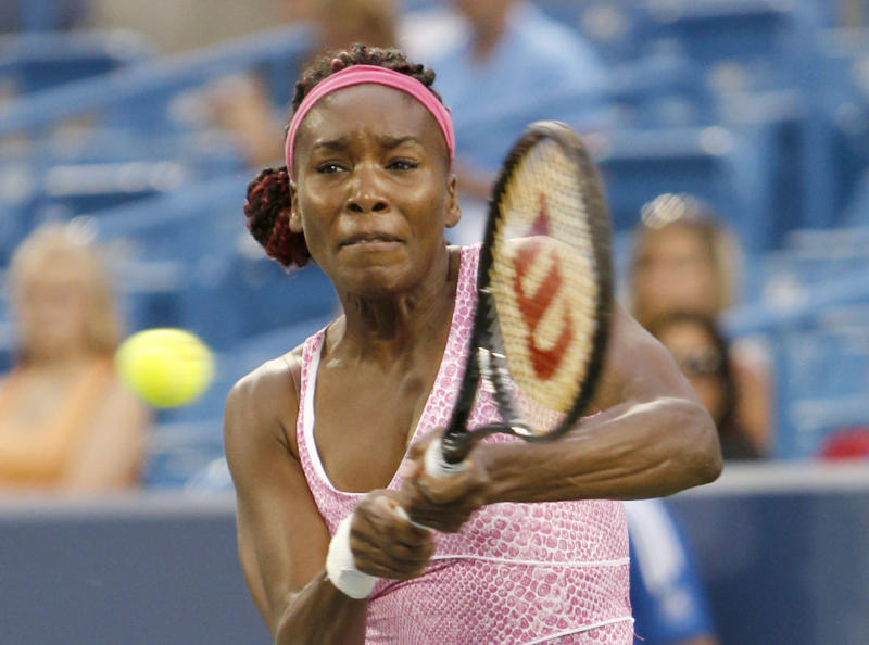 Venus Williams, from the United States, hits a backhand against Jana Cepelova, from Slovakia, during a match at the Western & Southern Open tennis tournament on Monday, Aug.12, 2013, in Mason, Ohio. Williams won 6-4, 6-1. (AP Photo/David Kohl)