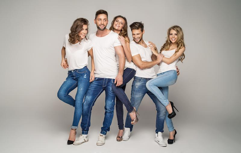A group of young people wearing jeans.