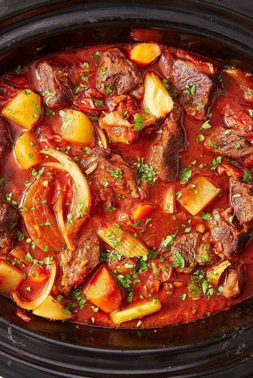 """<p>If you need an excuse to get your slow cooker out, this is it! Let everything cook together for hours for the deepest, most satisfying beef stew you'll try. Don't skip searing the beef — it creates more deeply flavoured meat that develops the flavour of the stew even further.</p><p>Get the <a href=""""https://www.delish.com/uk/cooking/recipes/a28830324/slow-cooker-red-wine-beef-stew-recipe/"""" rel=""""nofollow noopener"""" target=""""_blank"""" data-ylk=""""slk:Slow Cooker Red Wine Beef Stew"""" class=""""link rapid-noclick-resp"""">Slow Cooker Red Wine Beef Stew</a> recipe.</p>"""
