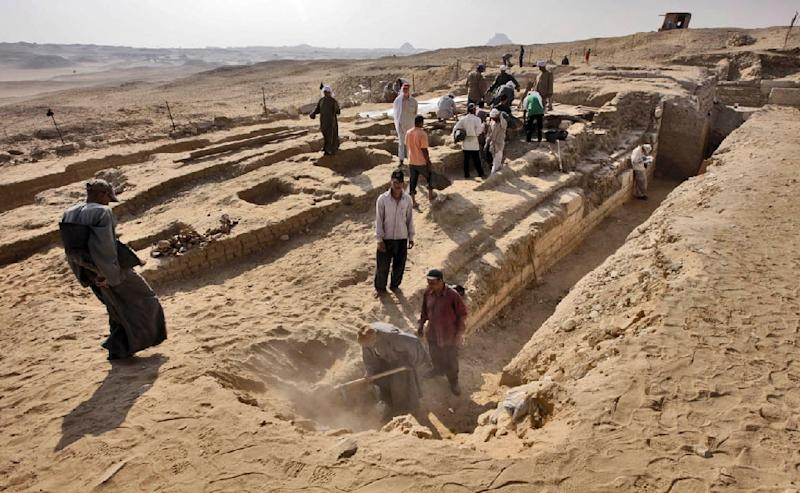 Archaeologists excavate a 4,000 year old tomb which was discovered in Abusir on the outskirts of the Egyptian capital, Cairo on October 22, 2013