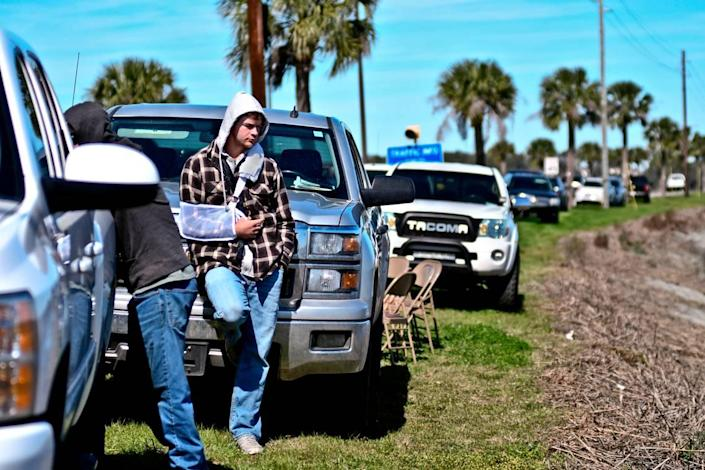 Anthony Cook leans against a truck near Archers Creek where crews were searching for his girlfriend, Mallory Beach, around noon on Monday, Feb. 25, 2019. The couple was on board a boat early Sunday morning when it crashed near the bridge leading onto Parris Island.