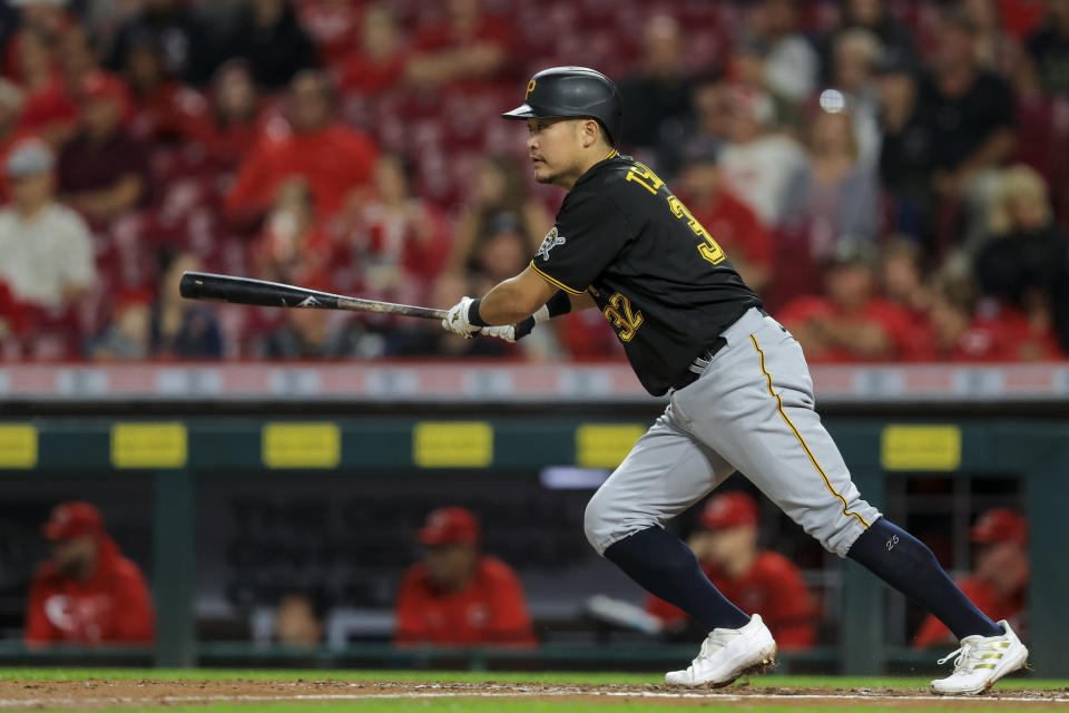 Pittsburgh Pirates' Yoshi Tsutsugo hits an RBI-single during the third inning of a baseball game against the Cincinnati Reds in Cincinnati, Monday, Sept. 20, 2021. (AP Photo/Aaron Doster)
