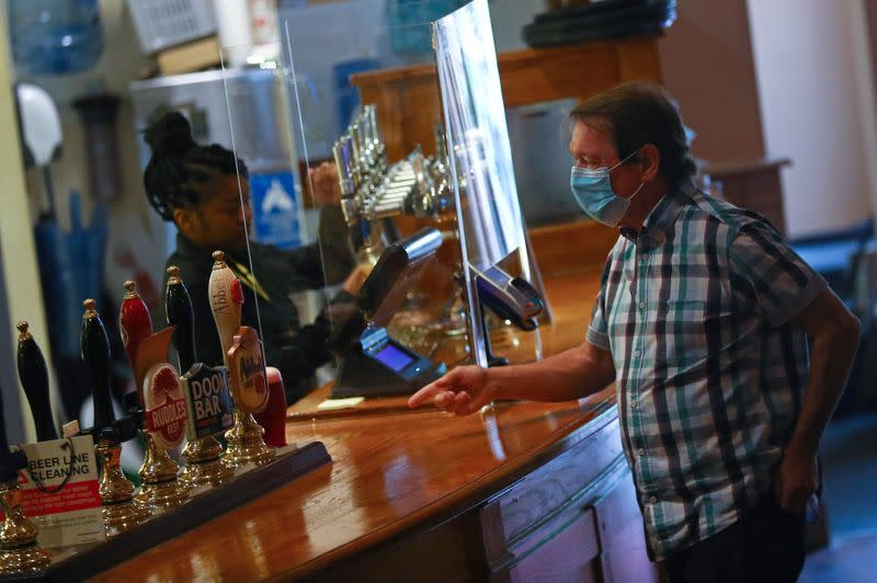 'Beautiful' to have a pint, 'brilliant' to get a haircut - England reopens after lockdown