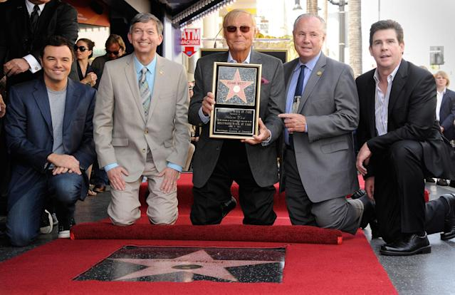 <p>Actor Adam West (C) poses with actor and producer Seth MacFarlane (L), Hollywood Chamber of Commerce President and CEO Leron Gubler, City Councilmember Tom LaBonge, and radio personality Ralph Garman, after receiving a star on the Hollywood Walk of Fame in Los Angeles, Calif., April 5, 2012. (Photo: Phil McCarten/Reuters) </p>