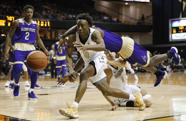 Vanderbilt guard Saben Lee (0) tries to keep the ball in bounds as Alcorn State guard Khari Jabriel Allen dives past Vanderbilt forward Yanni Wetzell (1) in the second half of an NCAA college basketball game against Alcorn State Friday, Nov. 16, 2018, in Nashville, Tenn. Vanderbilt won 79-54. (AP Photo/Mark Humphrey)