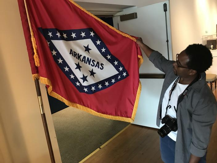 Jemar Tisby points out that the top star in the current Arkansas state flag represents the Confederacy. (Photo: Jon Ward/Yahoo News)
