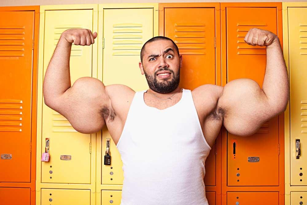 This real life Popeye set the record for the world's biggest arms, measuring 31in each. Moustafa Ismail, from Egypt, denies any use of steroids, shuns spinach and works out everyday in a suburb in Boston, America. He eats a gruelling diet of seven pounds of protein, nine pounds of carbohydrates and three gallons of water each day (Guinness World Records)