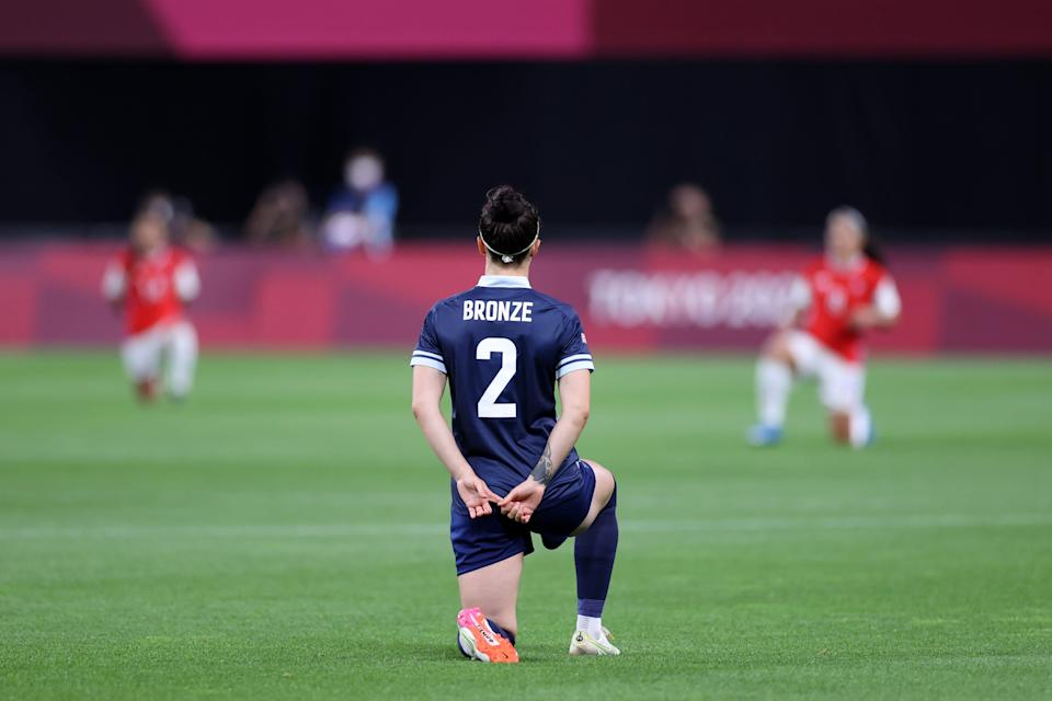 Great Britain's Lucy Bronze takes a knee before Wednesday's Olympic opener vs. Chile.