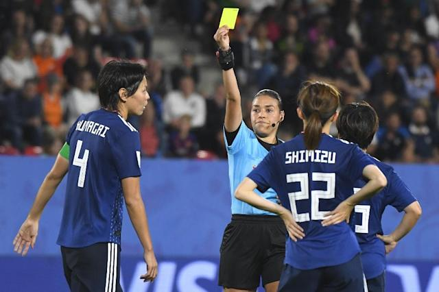 Japan skipper Saki Kumagai (L) was booked after being penalised for the handball which led to the Netherlands' winner (AFP Photo/Damien MEYER)