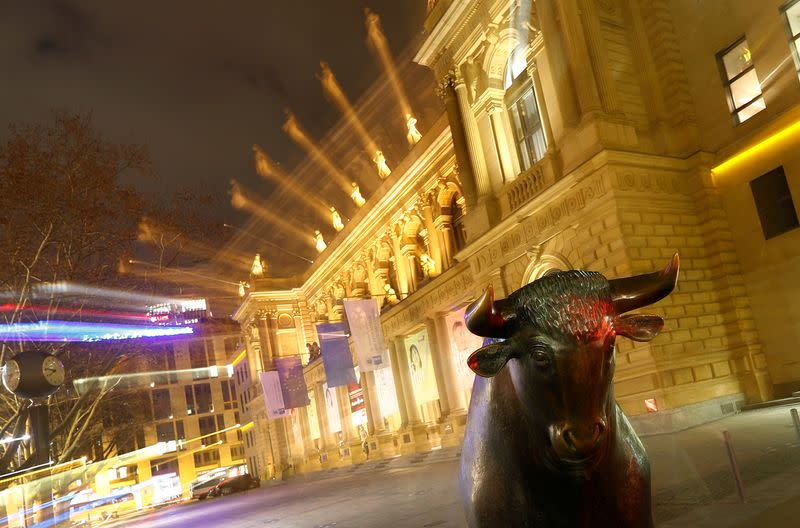FILE PHOTO: The bull, symbol for successful trading, is seen in front of the German stock exchange (Deutsche Boerse) in Frankfurt
