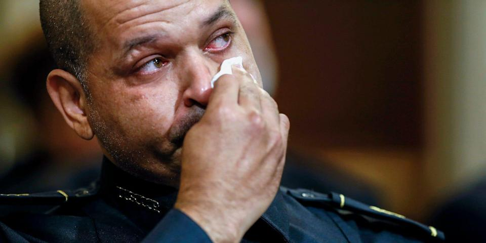 A US Capitol Police officer, Aquilino Gonell, wiping away tears.