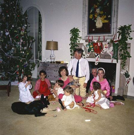 President John F. Kennedy celebrates Christmas with his family at the residence of C. Michael Paul in Palm Beach, Florida, U.S., December 25, 1962.   Caroline Kennedy (L to R), Gustavo Paredes, First Lady Jacqueline Kennedy, holding her nephew Anthony Radziwill; John F. Kennedy, Jr.; President Kennedy; Prince Stanislaus Radziwill of Poland; Princess Lee Radziwill (Mrs. Kennedy's sister), holding her daughter and Anna Christina Radziwill.  Courtesy Cecil Stoughton/JFK Library/Handout via REUTERS